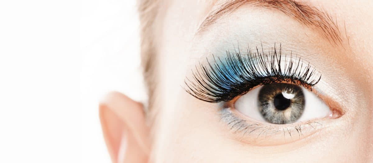 eye with long lashes from lash extensions and lash tinting