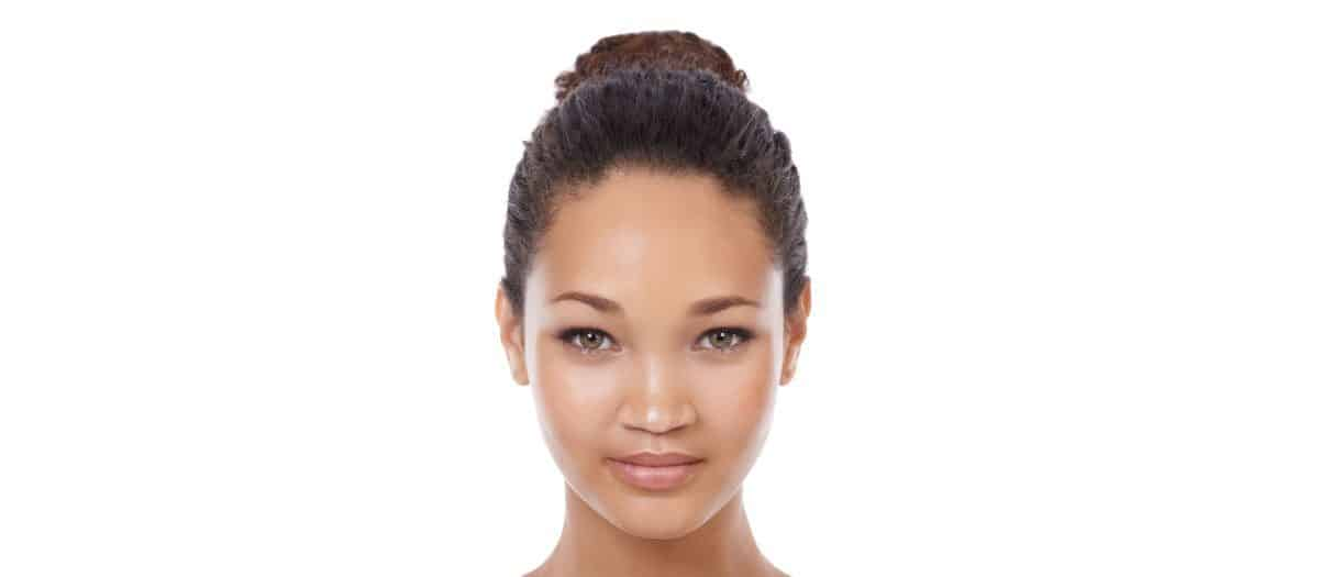 beautiful woman with radiant skin from dermaplaning