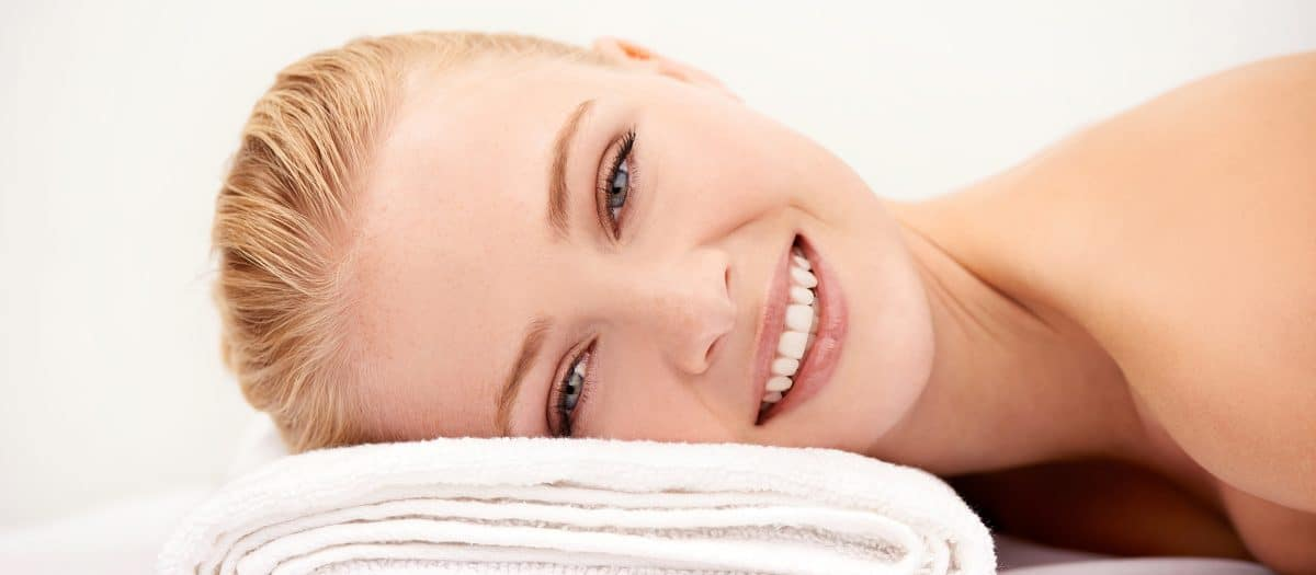 woman with clear skin from acne treatments